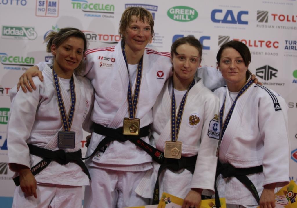 Filzmoser takes legendary medal for Austria
