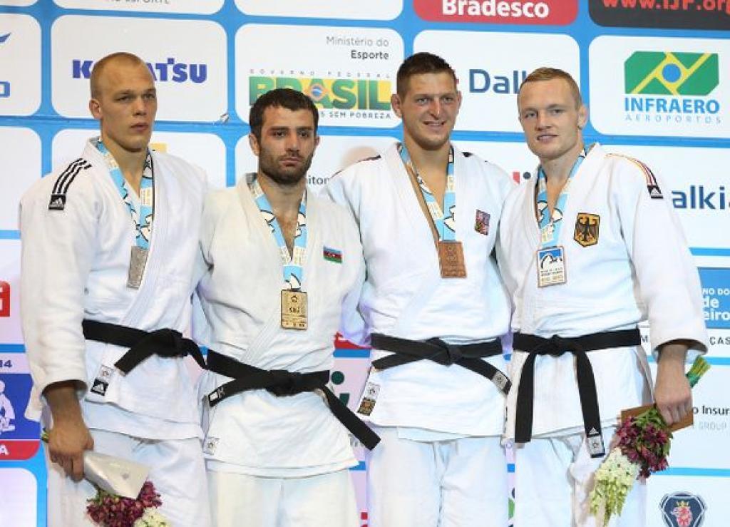 Riner and Mammadov claim World titles